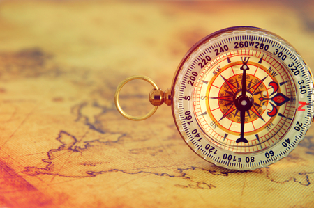 image of old compass over vintage map. selective focus Stock Photo