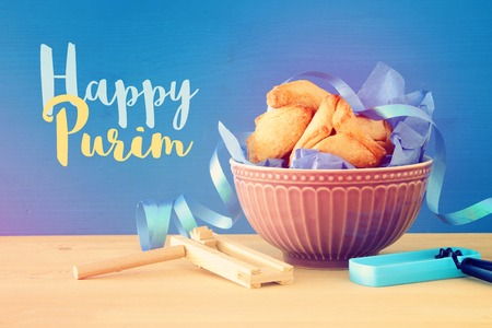 Purim celebration concept (jewish carnival holiday). Traditional hamantaschen cookies