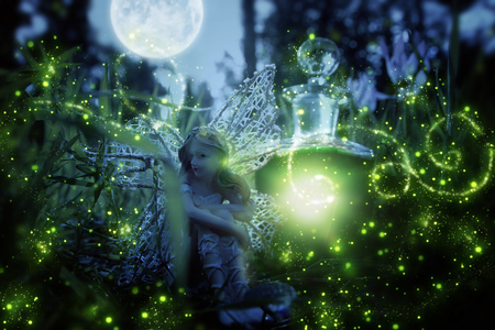 image of magical little fairy sitting in the night forest