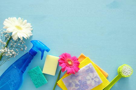 Spring cleaning concept with supplies on wooden table. Top view Stockfoto