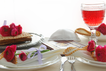 Pesah celebration concept (jewish Passover holiday festive table). Traditional book with text in hebrew: Passover Haggadah (Passover Tale)