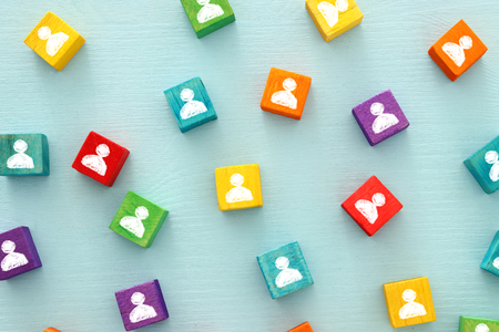 image of colorful blocks with people icons over wooden table ,human resources and management concept Standard-Bild