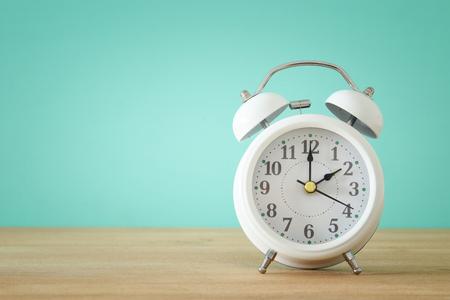 Image of spring Time Change. Summer back concept. Vintage alarm Clock over wooden table Stock Photo - 96042406