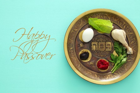 Pesah celebration concept (jewish Passover holiday). Traditional pesah plate with five symbols: horseradish, celery, egg, bone, maror, charoset Stockfoto