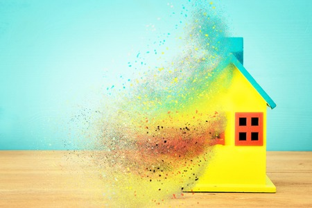 Image of wooden colorful house model. Real estate and uncertainty concept Stock Photo
