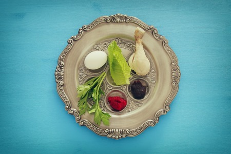 Pesah celebration concept (jewish Passover holiday). Traditional pesah plate with five symbols: horseradish, celery, egg, bone, maror, charoset Stock Photo
