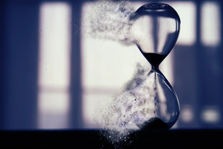 Hourglass as time passing and pass away concept