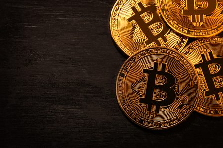 Golden Bitcoin over black background. Business concept