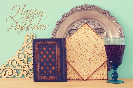 Pesah celebration concept (jewish Passover holiday). Translation for Hebrew Text: egg, bone