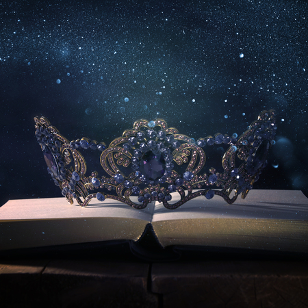 low key image of beautiful queen/king crown over wooden table. vintage filtered. fantasy medieval period Standard-Bild