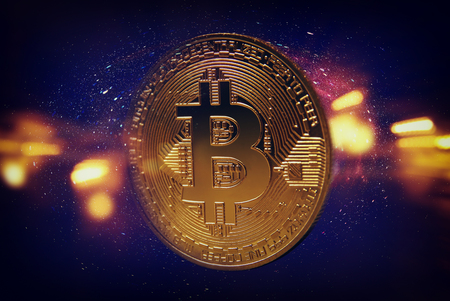 Golden Bitcoin over dark background. Business and virtual cryptocurrency concept