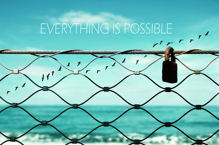 freedom concept. image fence and old rusty lock and birds flying in the horizon. everything is possible slogan 스톡 콘텐츠