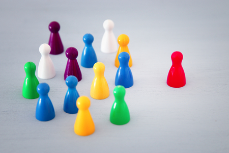 image of colorful game figures over wooden table ,human resources and management concept
