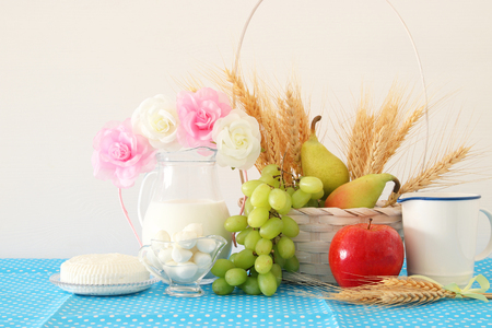 image of dairy products and fruits over wooden background. Symbols of jewish holiday - Shavuot 스톡 콘텐츠