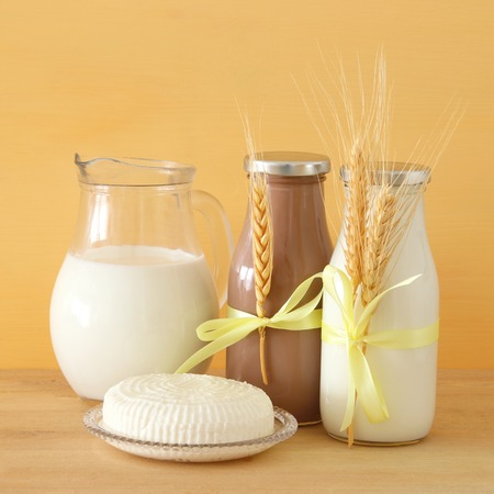 image of dairy products over wooden background. Symbols of jewish holiday - Shavuot