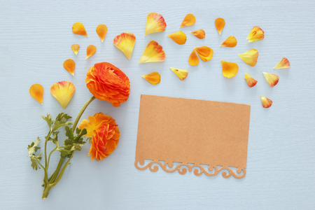 Top view of delicate orange and yellow beautiful flowers arrangement over blue wooden background. Flat lay, top view Stock Photo