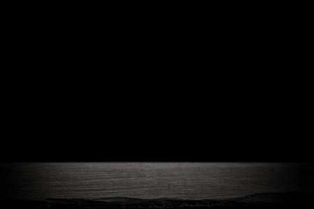 Spotlight concrete on slate board. dark black background