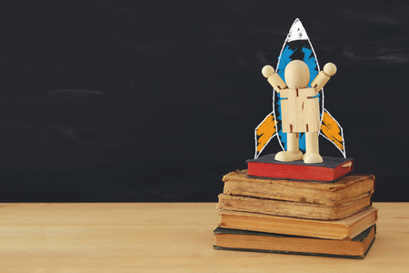 rocket and space sketches with wooden dummy in front of classroom blackboard Stock Photo