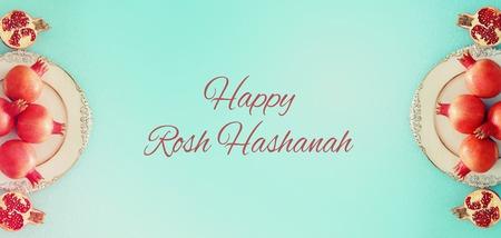 Rosh hashanah (jewish New Year holiday) concept. Pomegranate raditional symbol