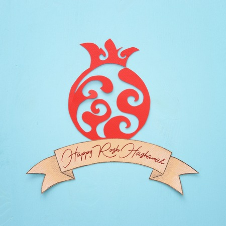 Rosh hashanah (jewish New Year holiday) concept. Traditional symbol POMEGRANATE shape carved from paper Stock Photo
