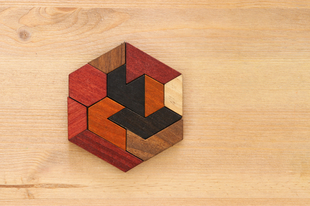 square tangram puzzle, over wooden table