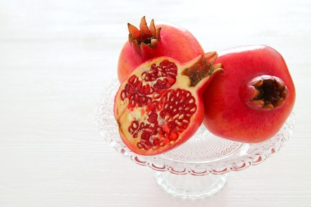 Rosh hashanah (jewish New Year holiday) concept. Pomegranate raditional symbol