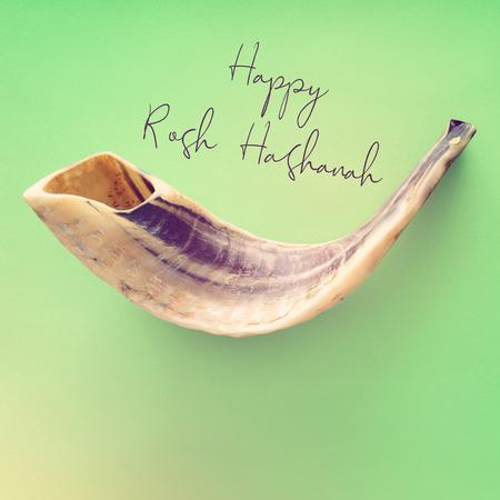 Rosh hashanah (jewish New Year holiday) concept. SHOFAR (HORN) Traditional symbol