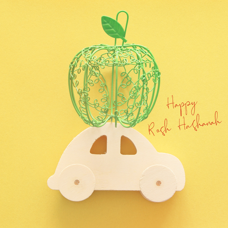 Flat lay image of green decorative apple over wooden car. Rosh hashanah (jewish New Year holiday) concept