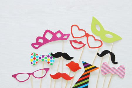 Top view image of funny and colorful photo booth props for party over white background 写真素材