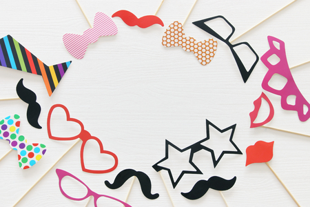Top view image of funny and colorful photo booth props for party over white background Stock Photo