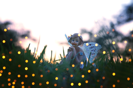 image of magical little fairy in the forest at sunset