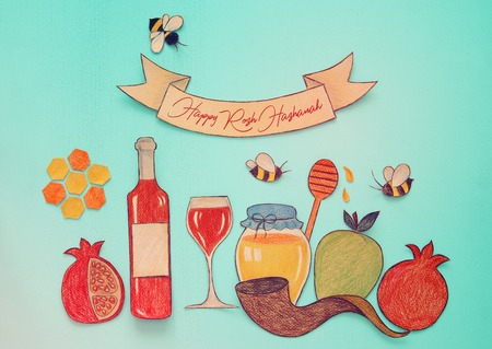 Rosh hashanah (jewish New Year holiday) concept. Traditional symbols shapes cut from paper and painted