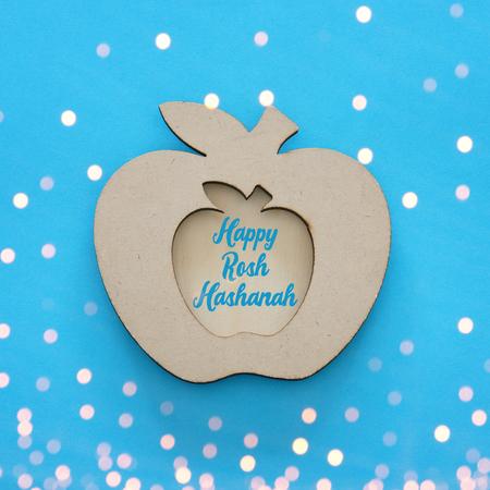Rosh hashanah (jewish New Year holiday) concept. Traditional symbol, decorative wooden apple