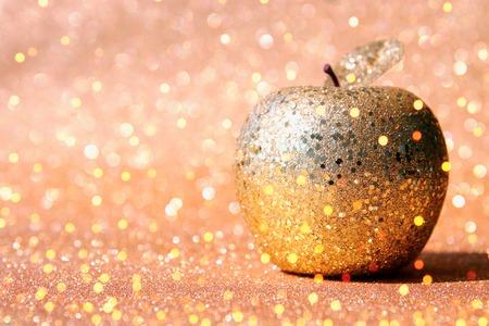Rosh hashanah (jewish New Year holiday) concept. Traditional symbol, decorative glitter gold apple