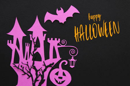Halloween holiday concept. haunted witch house over black background. Top view, flat lay Stock Photo