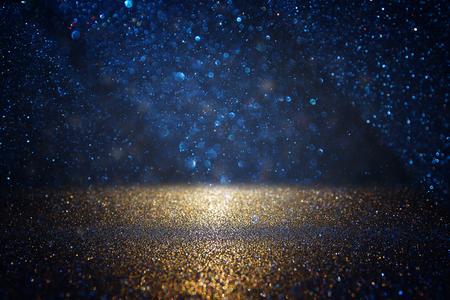 glitter vintage lights background. black, blue and gold. de-focused Foto de archivo