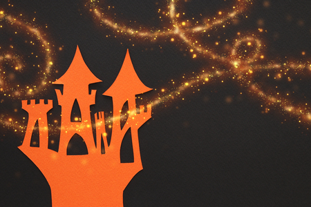 Castle over black paper background and glowing golden lights Stock Photo