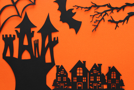 Halloween holiday concept. haunted witch house over orange background. Top view, flat lay