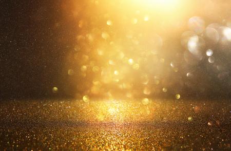 glitter vintage lights background. black and gold. de-focused