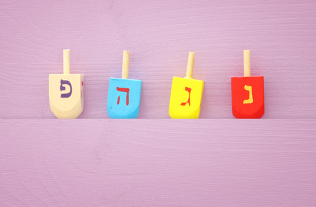 jewish holiday Hanukkah image background with traditional spinnig top.
