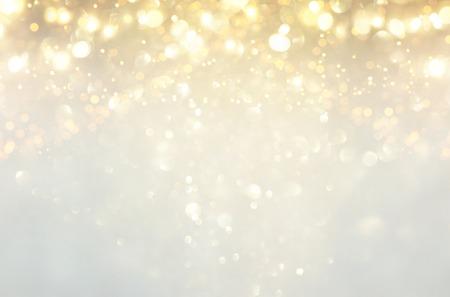 glitter vintage lights background. silver, gold and white. de-focused Archivio Fotografico
