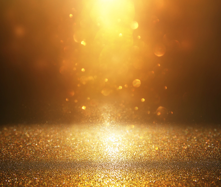 Glitter vintage lights background. Silver and gold, de-focused