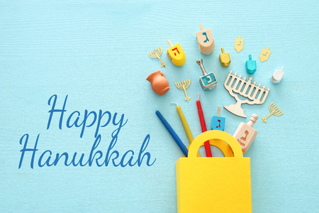 Top view image of Jewish holiday Hanukkah background with traditional spinning top, menorah (traditional candelabra) and candles
