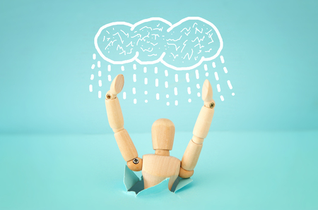 Image of drowning wooden dummy with worried stressed thoughts. depression, obsessive compulsive, adhd, anxiety disorders concept Stock Photo