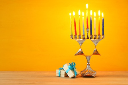 image of jewish holiday Hanukkah background with menorah (traditional candelabra) and burning candles Stock Photo