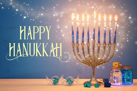 Image of Jewish holiday Hanukkah background with menorah (traditional candelabra) and candles Zdjęcie Seryjne
