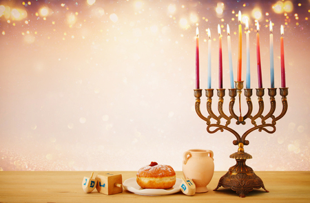 Image of Jewish holiday Hanukkah background with menorah (traditional candelabra) and candles over glitter shiny background Stock Photo