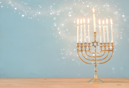 Image of Jewish holiday Hanukkah background with menorah (traditional candelabra) and candles Stock Photo