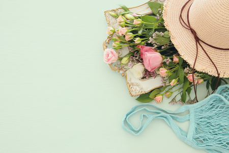 Image of aromatic flowers over pastel wooden table