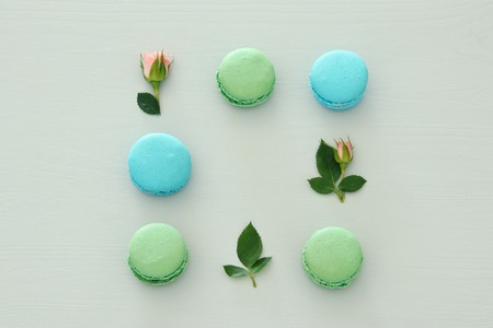 Top view of colorful macaroon over pastel background. Flat lay